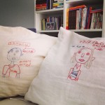 Embroidered portraits on cushion covers