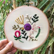 Embroidered flowers on hoop